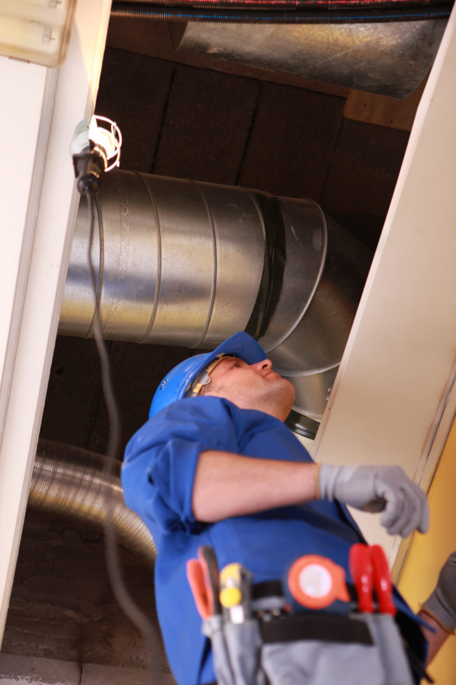 HVAC commercial air conditioning service worker in Raleigh, NC